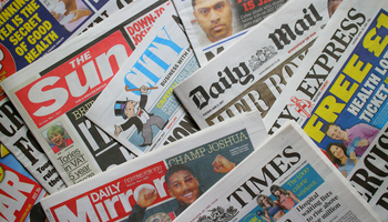 image_of_plie_of_newspapers